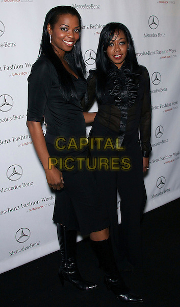 VANESSA WILLIAMS & TICHINA ARNOLD.Mercedes-Benz Fall 2006 L.A. Fashion Week - Louis Verdad - Arrivals held at Smashbox Studios, Culver City, California, USA. .March 19th, 2006.Photo: Zach Lipp/AdMedia/Capital Pictures.Ref: ZL/ADM.full length ruffles black sheer blouse skirt boots.www.capitalpictures.com.sales@capitalpictures.com.© Capital Pictures.