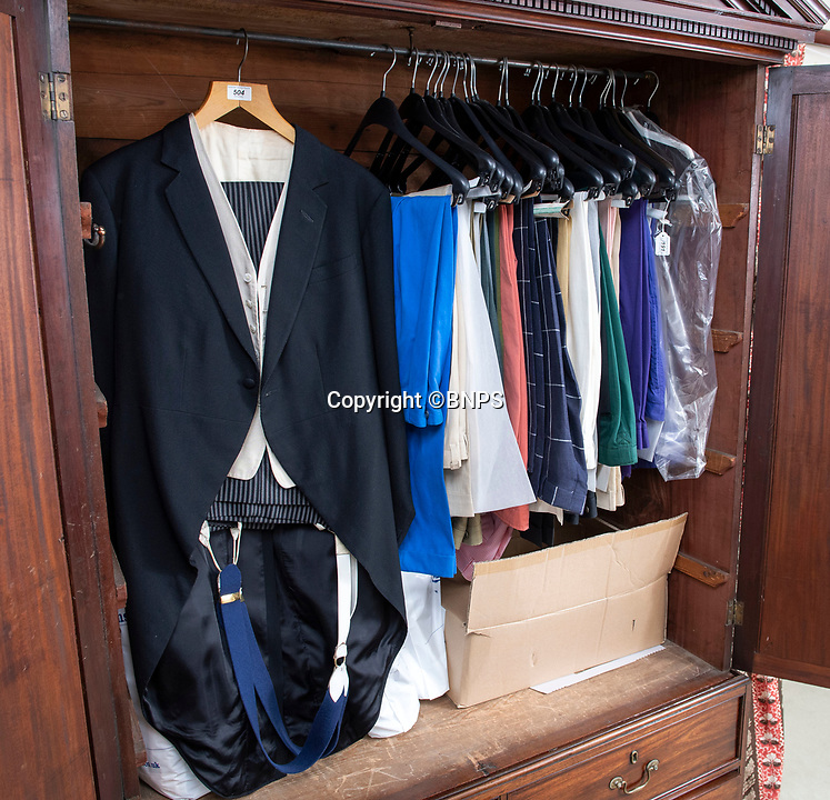 BNPS.co.uk (01202 558833)<br /> Pic: PhilYeomans/BNPS<br /> <br /> The house still contain's wardrobe's full of his clothes.<br /> <br /> A remarkable 'time warp' Royal archive amassed by the Queen's dressmaker has been found inside his old country home.<br /> <br /> The late Ian Thomas was a dress designer for members of the Royal Family, including Her Majesty, for over 30 years.<br /> <br /> As an apprentice he worked alongside the renowned fashion designer Norman Hartnell on creating the Queen's coronation dress in 1953.<br /> <br /> His archive includes embroidered samples of the gown worn by Elizabeth II for the historic ceremony in Westminster Abbey that was broadcast to millions.<br /> <br /> Mr Thomas also designed outfits for the Queen Mother and Princess Margaret.