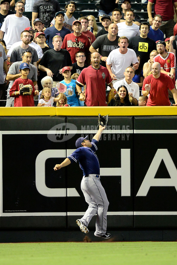 Jul. 3, 2012; Phoenix, AZ, USA: San Diego Padres outfielder Carlos Quentin makes a leaping catch in the third inning against the Arizona Diamondbacks at Chase Field. Mandatory Credit: Mark J. Rebilas-