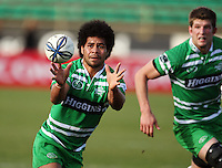 Manawatu centre Tevita Taufui takes a pass during the Air NZ Cup preseason match between Manawatu Turbos and Wellington Lions at FMG Stadium, Palmerston North, New Zealand on Friday, 17 July 2009. Photo: Dave Lintott / lintottphoto.co.nz