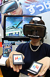 "June 10, 2016, Tokyo, Japan - An employee of Japanese toy maker MegaHouse demonstrates virtual reality toy ""BotsNew"" using a smart phone inside the unit and handy controlers at the annual Tokyo Toy Show in Tokyo on Friday, June 10, 2016. Some 160,000 people are expecting to visit the four-day toy trade show.   (Photo by Yoshio Tsunoda/AFLO) LWX -ytd-"