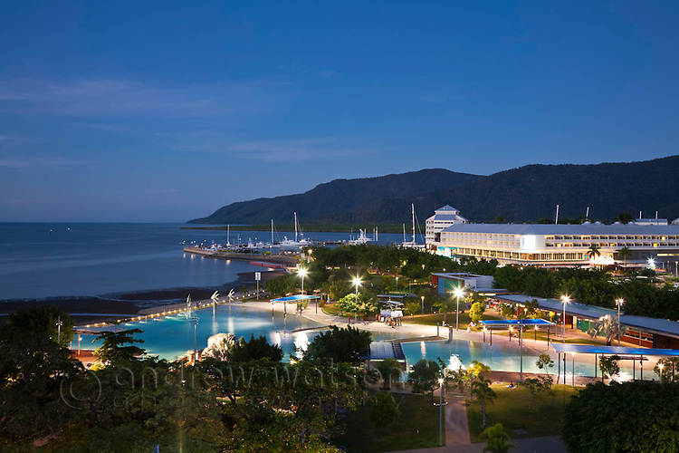 Esplanade Lagoon at dusk with The Pier at the Marina in background.  Cairns, Queensland, Australia