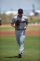 AZL Indians Red first baseman Joe Naranjo (24) jogs off the field between innings of an Arizona League game against the AZL Indians Blue on July 7, 2019 at the Cleveland Indians Spring Training Complex in Goodyear, Arizona. The AZL Indians Blue defeated the AZL Indians Red 5-4. (Zachary Lucy/Four Seam Images)