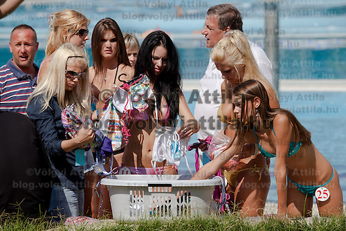 Participants look for swimmingsuites during the Miss Bikini Hungary beauty contest held in Budapest, Hungary. Sunday, 29. August 2010. ATTILA VOLGYI