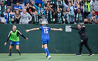 Seattle, WA - Saturday Aug. 27, 2016: Elli Reed, Megan Rapinoe celebrates scoring, Laura Harvey during a regular season National Women's Soccer League (NWSL) match between the Seattle Reign FC and the Portland Thorns FC at Memorial Stadium.