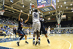 02 January 2012: Duke's Chelsea Gray (12) beats the defensive trap set by Virginia's Ataira Franklin (23) and Ariana Moorer (15). The Duke University Blue Devils defeated the University of Virginia Cavaliers 77-66 at Cameron Indoor Stadium in Durham, North Carolina in an NCAA Division I Women's basketball game.