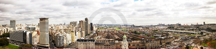 Bird's eye Wide Panoramic view over the city skyline. In the foreground The Retiro train station FCG Mitre, left modern apartment and office buildings in the Retiro and Recoleta part of the city, right the harbour. Buenos Aires Argentina, South America