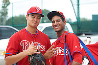GCL Phillies Jordan Kurokawa (left) and Daniel Brito (right) after a game against the GCL Pirates on August 6, 2016 at Pirate City in Bradenton, Florida.  GCL Phillies defeated the GCL Pirates 4-1.  (Mike Janes/Four Seam Images)