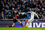 Luka Modric of Real Madrid (R) competes for the ball with Santiago Comesana, Santi Comesana, of Rayo Vallecano during the La Liga 2018-19 match between Real Madrid and Rayo Vallencano at Estadio Santiago Bernabeu on December 15 2018 in Madrid, Spain. Photo by Diego Souto / Power Sport Images