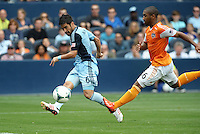 Paulo Nagamura  (6) midfield Sporting KC crosses the ball in front of Corey Ashe (26) defender Houston Dynamo .   .Sporting Kansas City and Houston Dynamo played to a 1-1 tie at Sporting Park, Kansas City, Kansas.
