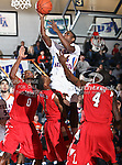 Texas-Arlington Mavericks guard Bryant Smith (24) goes in for a lay up in the game between the Lamar University Cardinals and the University of Texas-Arlington Mavericks held at the University of Texas in Arlington's Texas Hall in Arlington, Texas. Lamar defeats UTA 76 to 72
