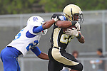 Palos Verdes, CA 09/16/11 - Okuoma Idah (Peninsula #24) and Ronald Jones (Culver City #26) in action during the Culver City-Peninsula varsity football game.