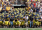30 August 2008: Michigan head coach Rich Rodriguez leads his team onto the field before an NCAA college football game between the Michigan Wolverines and the Utah Utes, at Michigan Stadium in Ann Arbor, Michigan. Utah upset Michigan, winning 25-23.