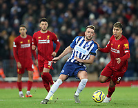 30th November 2019; Anfield, Liverpool, Merseyside, England; English Premier League Football, Liverpool versus Brighton and Hove Albion; Dale Stephens of Brighton and Hove Albion competes for the ball with Roberto Firmino of Liverpool  - Strictly Editorial Use Only. No use with unauthorized audio, video, data, fixture lists, club/league logos or 'live' services. Online in-match use limited to 120 images, no video emulation. No use in betting, games or single club/league/player publications