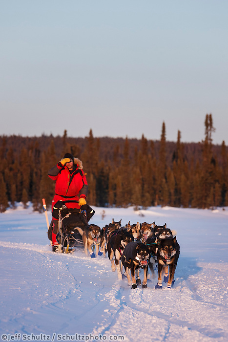 Nathan Schroeder approaches the Cripple checkpoint on Thursday, March 6, during the Iditarod Sled Dog Race 2014.<br /> <br /> PHOTO (c) BY JEFF SCHULTZ/IditarodPhotos.com -- REPRODUCTION PROHIBITED WITHOUT PERMISSION