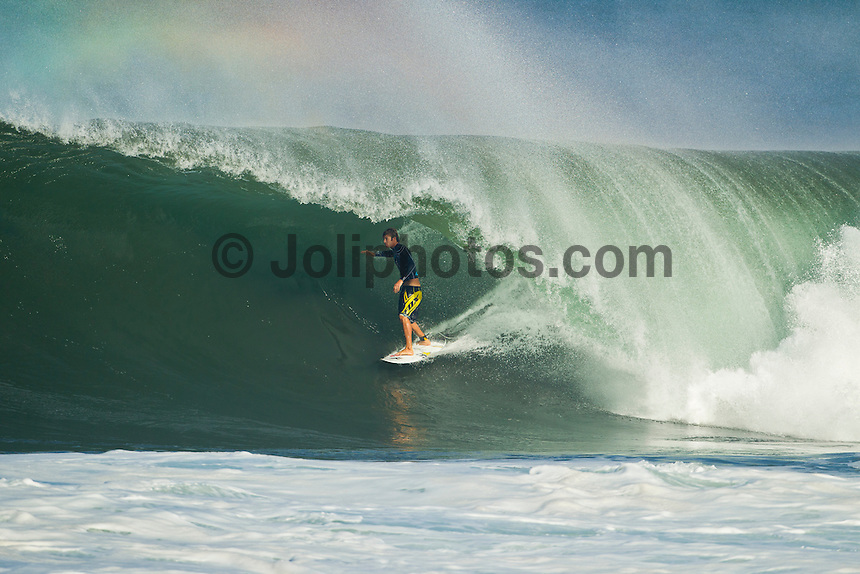 Pipeline, Haleiwa, Oahu, Hawaii (Saturday January 22, 2011) Eric Geiselman (USA) pulling in at Backdoor. .The 6'-10 west swell continued to hit the North Shore today with Pipeline and Backdoor  breaking. Photo: joliphotos.com