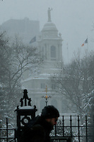 A man walks under the snow in front of the New York City Hall during the pass of the winter storm JONAS, in New York, 01/23/2016. Photo by VIEWpress