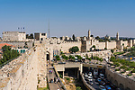 The city wall of Jerusalem near the Jaffa Gate with the Tower of Phasael at left and the minaret of the Tower of David or the Citadel in the center.  At right is the church and bell tower of the Dormition Abbey on Mount Zion, outside the walls.  The Old City of Jerusalem and its Walls is a UNESCO World Heritage Site.
