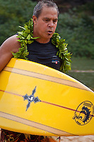 HALEIWA, HI (Thursday Dec. 3, 2009) Clyde Aikau (HAW) the brother of Eddie Aikau and past winner of the event at the opening ceremony of the 2009-2010 Quiksilver in Memory of Eddie Aikau was held today at Waimea Bay. This year's event is the 25th Anniversary  and will be held on one day , between December 1, 2009 and February 28, 2010, when the waves eceed the  20 foot  minimum threshold and the 28 invitees will compete for the $98.000 prize purse...The northern hemisphere winter months on the North Shore signal a concentration of surfing activity with some of the best surfers in the world taking advantage of swells originating in the stormy Northern Pacific. Notable North Shore spots include Waimea Bay, Off The Wall, Backdoor, Log Cabins, Rockpiles and Sunset Beach... Ehukai Beach is more  commonly known as Pipeline and is the most notable surfing spot on the North Shore. It is considered a prime spot for competitions due to its close proximity to the beach, giving spectators, judges, and photographers a great view...The North Shore is considered to be one the surfing world's must see locations and every December hosts three competitions, which make up the Triple Crown of Surfing. The three men's competitions are the Reef Hawaiian Pro at Haleiwa, the O'Neill World Cup of Surfing at Sunset Beach, and the Billabong Pipeline Masters. The three women's competitions are the Reef Hawaiian Pro at Haleiwa, the Gidget Pro at Sunset Beach, and the Billabong Pro on the neighboring island of Maui...Photo: Joliphotos.com