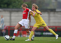 Jayne Ludlow of Arsenal is challenged by Adela Pivonkova - Arsenal Ladies vs Sparta Prague - UEFA Women's Champions League at Boreham Wood FC - 11/11/09 - MANDATORY CREDIT: Gavin Ellis/TGSPHOTO - Self billing applies where appropriate - Tel: 0845 094 6026