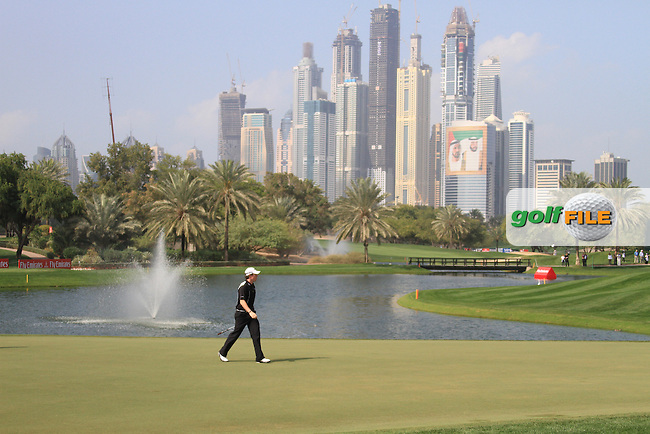 Rory McIlroy (NIR) walks the 4th green on day one of the Dubai Desert Classic 2011 on the Majlis Course, Emirates Golf Club, Dubai, UAE. 10/02/2011.Picture Fran Caffrey/www.golffile.ie.