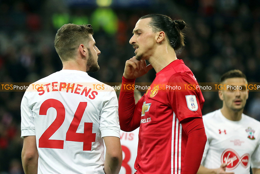 Jack Stephens of Southampton and Manchester United's Zlatan Ibrahimovic exchange words in the first half during Manchester United vs Southampton, EFL Cup Final Football at Wembley Stadium on 26th February 2017