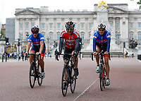 16th May 2020, London, England;  Cyclists cycling away from Buckingham Palace on the mall while not wearing gloves or a mask