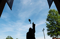 A Mississippi State College of Business graduate tosses her cap in front of McCool Hall. Soon-to-be graduates can be found taking celebratory pictures across campus as the university holds commencement ceremonies Thursday and Friday [May 3-4] at Humphrey Coliseum.<br />