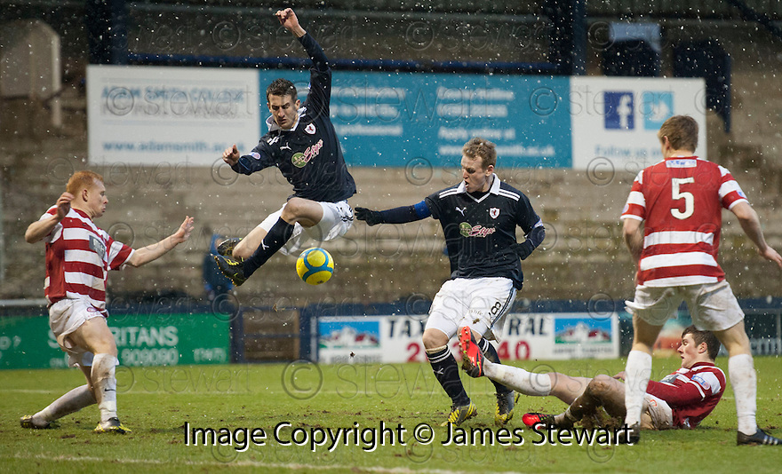Raith's Grant Anderson  and Allan Walker  get in each others way an miss a chance.