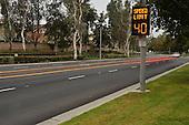 Cars speeding pass a traffic warning sign