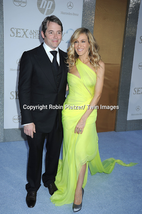 """Matthew Broderick and wife Sarah Jessica Parker posing for photographers at the world premiere of """"Sex and the City 2"""" on May 24, 2010 at Radio City Music Hall in New York City."""