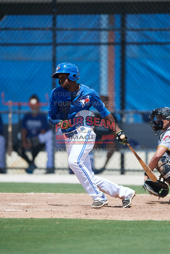 GCL Blue Jays shortstop Luis De Los Santos (1) follows through on a swing during a game against the GCL Pirates on July 20, 2017 at Bobby Mattick Training Center at Englebert Complex in Dunedin, Florida.  GCL Pirates defeated the GCL Blue Jays 11-6 in eleven innings.  (Mike Janes/Four Seam Images)