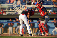 Batavia Muckdogs third baseman J.J. Gould (49) after getting hit in the head by a pitch as catcher Jeremy Martinez (41) tries to help during a game against the State College Spikes on June 24, 2016 at Dwyer Stadium in Batavia, New York.  State College defeated Batavia 10-3.  (Mike Janes/Four Seam Images)