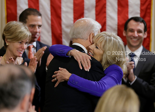 United States Vice President Joe Biden hugs his wife Jill Biden after taking the oath of office during and official ceremony at the Naval Observatory, Sunday, Jan. 20, 2013, in Washington. Vice President Biden was sworn in for a second term using the Biden Family Bible. .Credit: Carolyn Kaster / Pool via CNP
