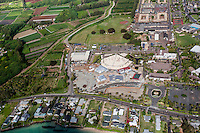 A helicopter tour offers an aerial view of Polynesian Cultural Center and surrounding La'ie, O'ahu.