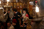 The Orthodox Patriarch Theophilos III of Jerusalem attends the Christmas mass celebrations at the Church of the Nativity, in the West Bank town of Bethlehem, 06 January 2019. The Church of the Nativity, built on the site where Jesus Christ is believed to have been born in the West Bank city of Bethlehem, is administered jointly by Greek Orthodox, Roman Catholic, Armenian Apostolic, and Syriac Orthodox church. Orthodox believers celebrate Christmas Day on 07 January, according to the Julian calendar. Photo by Wisam Hashlamoun