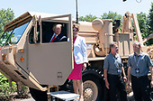 July 15, 2019 - Washington, DC, United States: United States President Donald J. Trump speaks with Lockheed Martin chairwoman, president and chief executive officer Marillyn Adams Hewson aboard a THAAD (Terminal High Altitude Area Defense) missile launcher on display at the 3rd Annual Made in America Product Showcase at the White House. <br /> Credit: Chris Kleponis / Pool via CNP