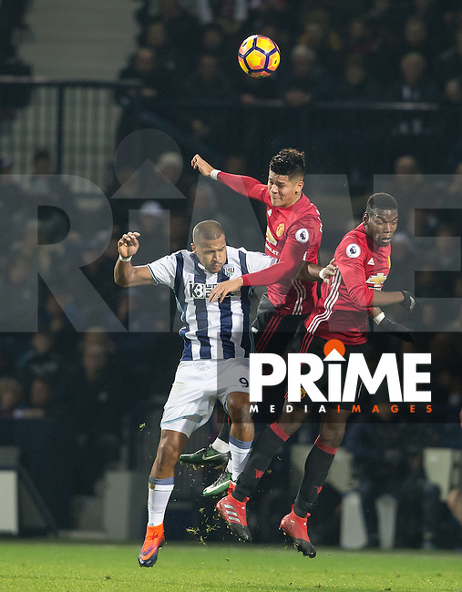 Marcos Rojo, Paul Pogba of Manchester United & Jose Salomon Rondon of West Bromwich Albion go up for the ball during the EPL - Premier League match between West Bromwich Albion and Manchester United at The Hawthorns, West Bromwich, England on 17 December 2016. Photo by Andy Rowland / PRiME Media Images.