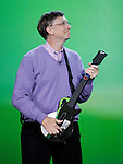 Microsoft chairman Bill Gates plays an XBox guitar during his keynote address at the Consumer Electronics Show (CES) in Las Vegas, Sunday, Jan. 6, 2008 . (AP Photo/Paul Sakuma)
