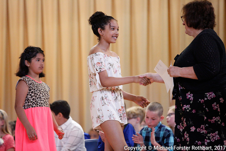 The Oneonta Greater Plains elementary school fifth grade awards ceremony, on June 21, 2017.<br /> &copy; Michael Forster Rothbart Photography<br /> www.mfrphoto.org &bull; 607-267-4893<br /> 34 Spruce St, Oneonta, NY 13820<br /> 86 Three Mile Pond Rd, Vassalboro, ME 04989<br /> info@mfrphoto.org<br /> Photo by: Michael Forster Rothbart<br /> Date:  6/21/2017<br /> File#:  Canon &mdash; Canon EOS 5D Mark III digital camera frame C19228