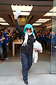 March 16, 2012, Tokyo, Japan - This woman leaves the Apple store happy after purchasing your new iPad. .Fans lined up overnight outside the Apple store in Ginza, to buy the new iPad. Japan was one of the first countries where Apple fans could get their hands on the new iPad.