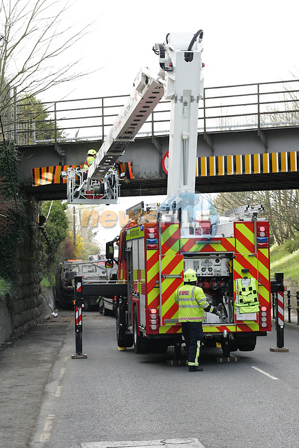 Scene of a road traffic accident where a  flatbed truck's crane collided with the railway bridge above..Picture: Shane Maguire / www.newsfile.ie.