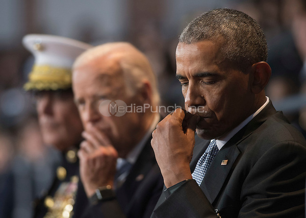 United States President Barack Obama (R), Vice President Joe Biden (C) and Chairman of the Joint Chiefs of Staff Gen. Joseph Dunford Jr. attends the Armed Forces Full Honor Review Farewell Ceremony for President Obama at Joint Base Myers-Henderson Hall, in Virginia on January 4, 2017. The five braces of the military honored the president and vice-president for their service as they conclude their final term in office.<br /> Credit: Kevin Dietsch / Pool via CNP /MediaPunch