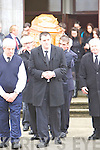 GRIEF: Patrick Hanrahan,.brother of murder victim.Michael, with Kayrena and.Marion, the victim's.daughters, at the funeral in.Moyvane on Wednesday.