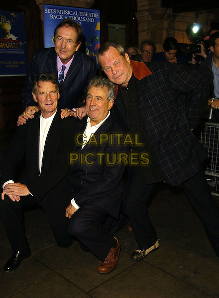 "ERIC IDLE, MICHAEL PALIN, TERRY GILIAM, TERRY JONES .Attends ""Monty Python's Spamalot"" VIP Gala Night, .Palace Theatre, London, England, October 17th 2006..full length kneeling bending.Ref: CAN.www.capitalpictures.com.sales@capitalpictures.com.©Can Nguyen/Capital Pictures"