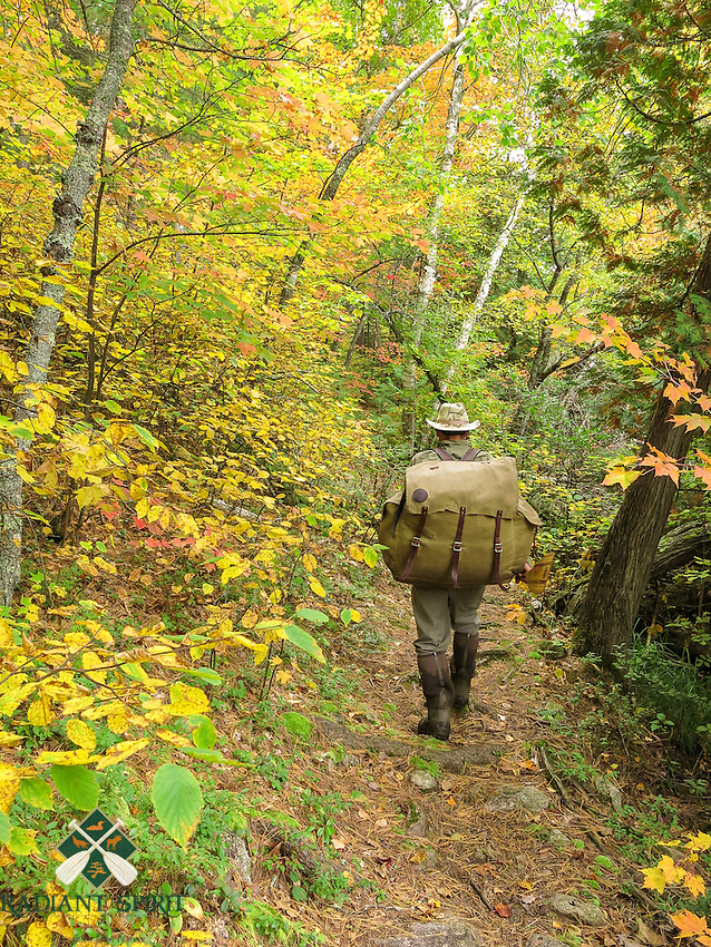 &quot;Fall Portage Enjoyment II&quot;<br /> <br /> I enjoy the scenic walk, cool temperatures, and bug-free portage trails of Quetico Provincial Park in late September and October.<br /> ~ Day 190 of Inspired by Wilderness: A Four Season Solo Canoe Journey.