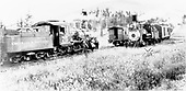 3/4 rear engineer's-side view of C&amp;S #75 meeting a passenger train.<br /> C&amp;S