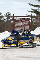 Snowmobiles parked at the Keweenaw Mountain Lodge in Copper Harbor Michigan in winter.