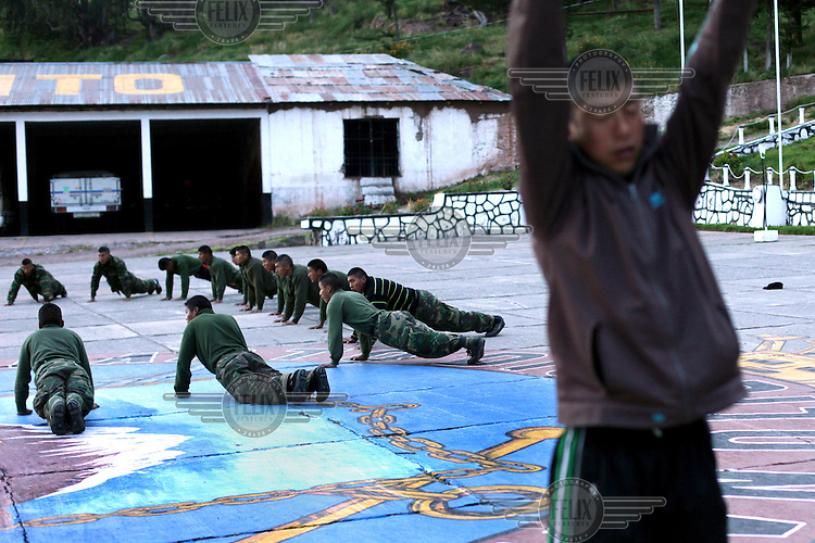 Bolivian Navy students during a physical education class at the naval base of San Pedro de Tiquina on the shores of Lake Titicaca. Bolivia lost what is now northern Chile in a war over nitrates leaving Bolivia without access to the ocean.