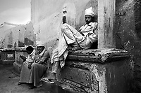 Cairo, Egypt, The City of the Dead, 2000 - Tomb guards and undertakers kill time sitting on grave markers.